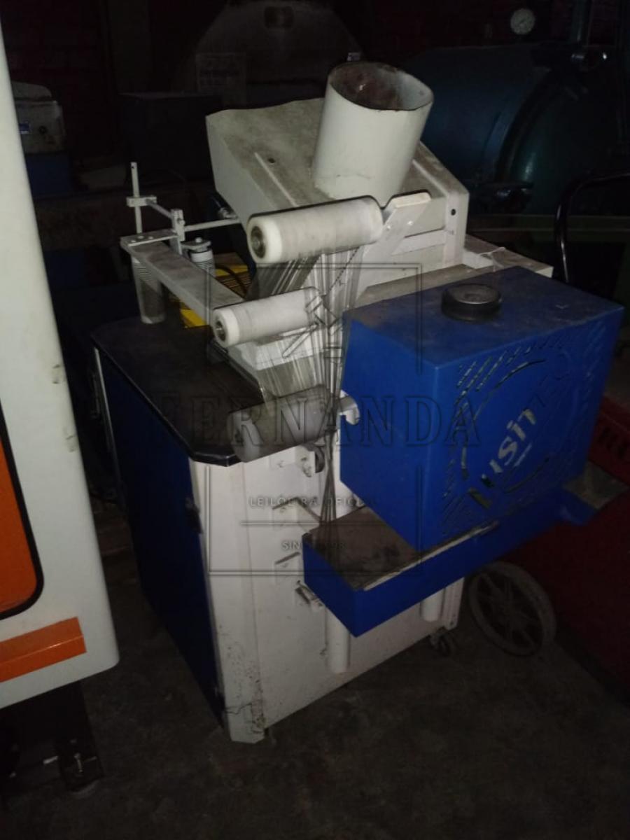 Uma maquina de fachete (tampogragrafia) narca lusitec em regular estado de e em funcionamento, rotação 180graus