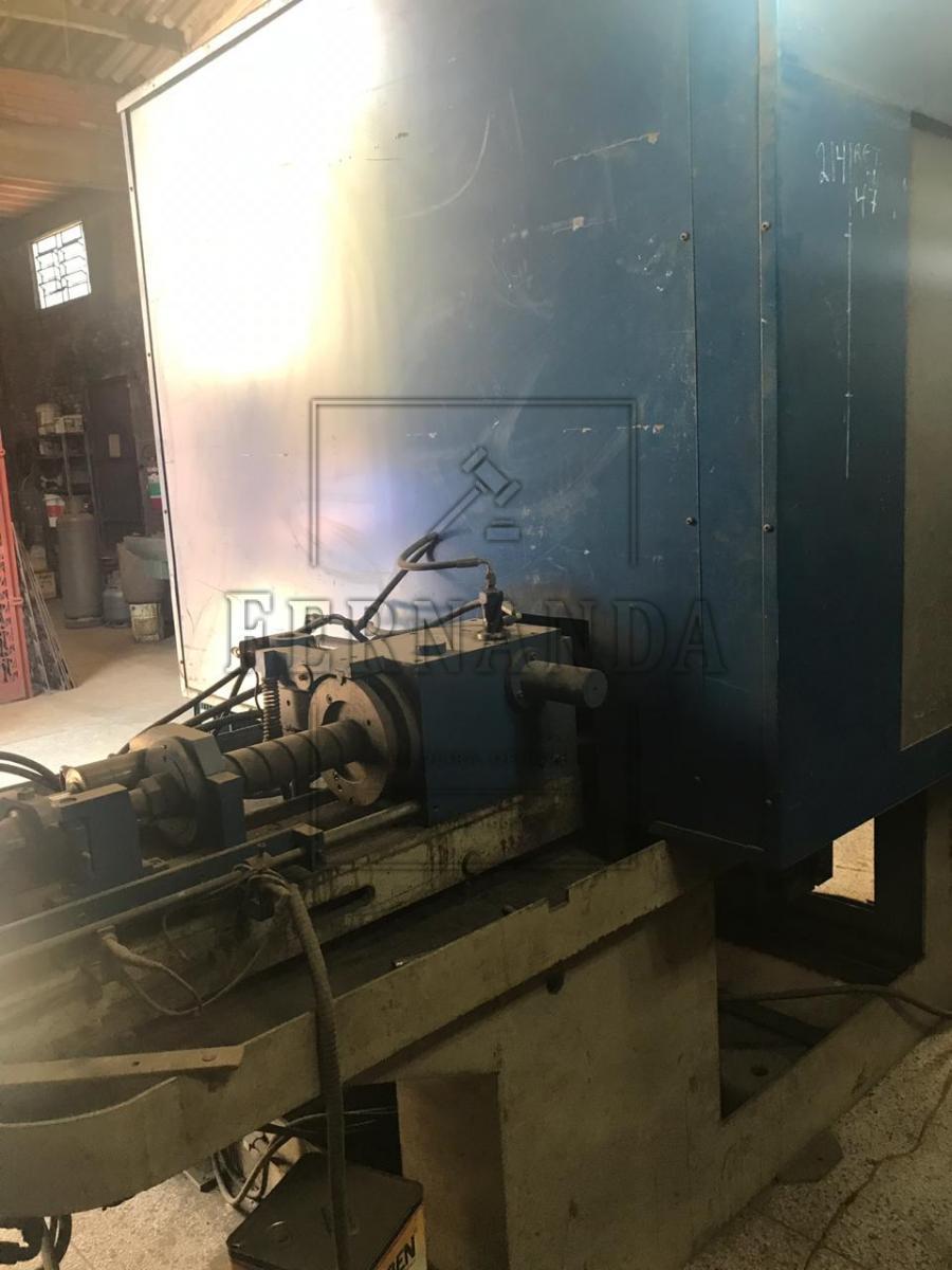 Maquina para fabricação de Pua 5/8'' e 1/2'' (broca para furadeira acoplada em motosserra), largura 1900mm, altura 2500mm, comprimento 3900mm, cor azul, tensão 380cv com cabeçote hidráulico e  utilização de rebolo de 600mm com rotação de 12.000rpm. Painel